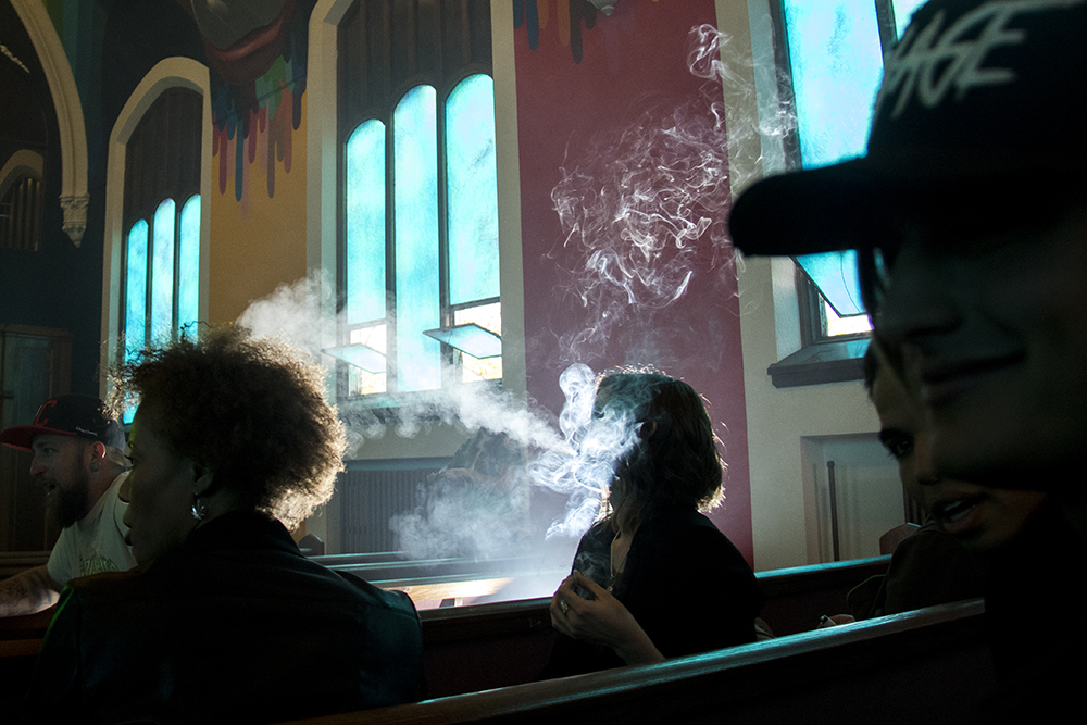 Mia Jane burns a jimmie at 4:22 inside the International Church of Cannabis on S. Logan Street, April 4, 2017. (Kevin J. Beaty/Denverite)  420; marijuana; international church of cannabis; washington park west; kevinjbeaty; denver; denverite; colorado;