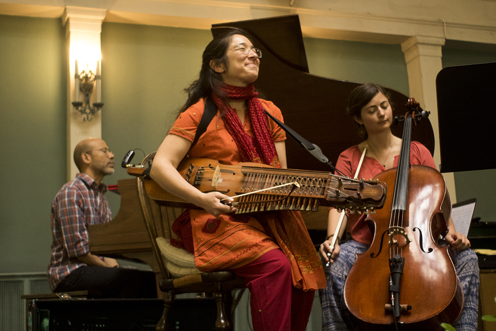 Musicians Victor Mestas (left to right), Sandra Wong and Joy Adams wait to play on stage. The Althea Center for Engaged Spirituality. (Kevin J. Beaty/Denverite)  althea center; church; cheesman park; denver; colorado; kevinjbeaty; denverite;