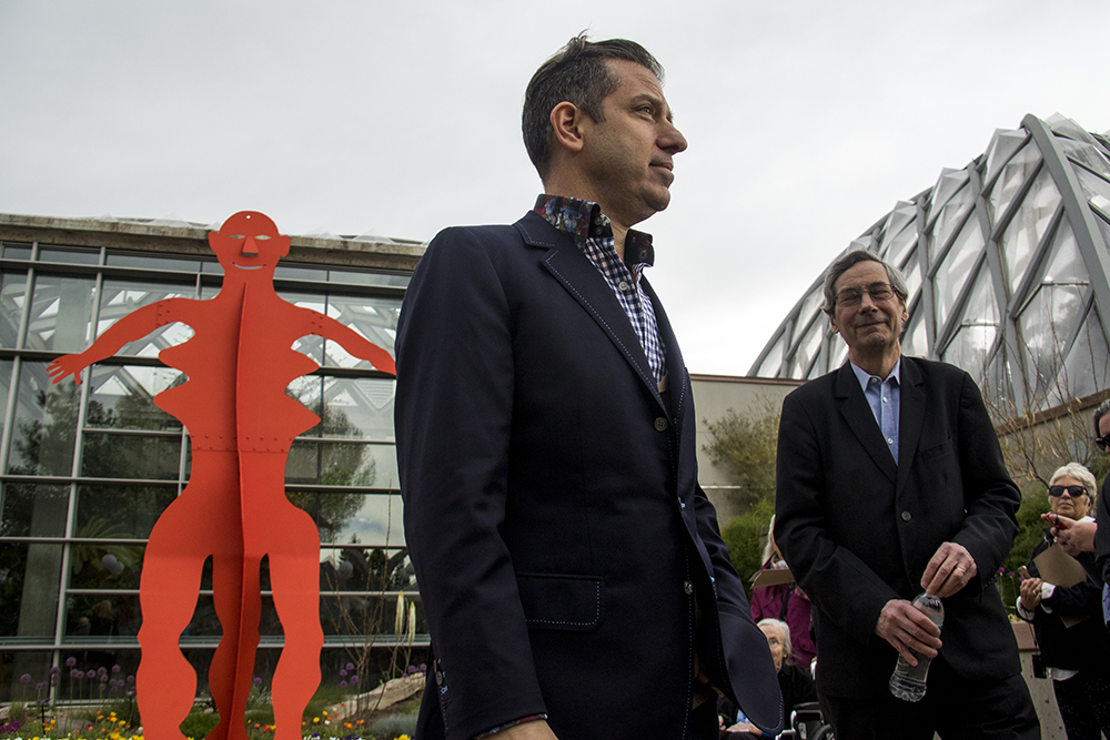 Curator Alfred Pacquement (right) and Sandy Rower explain Untitled, 1976. The opening of a show of Alexander Calder's work at the Denver Botanic Gardens, April 28, 2017. (Kevin J. Beaty/Denverite)  denver botanic gardens; alexander calder; art; sculpture; kevinjbeaty; museum; denver; denverite; colorado;