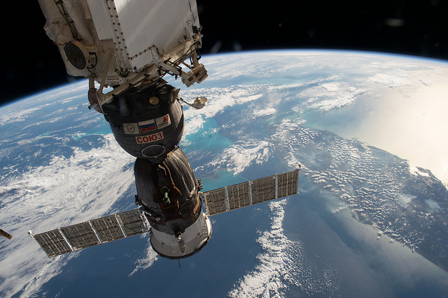 A Russian Soyuz spacecraft can be seen in this image from the International Space Station as it passes over the American state of Florida surrounded by the blue waters of the Gulf of Mexico on the west side and the Atlantic Ocean on the other. (NASA)