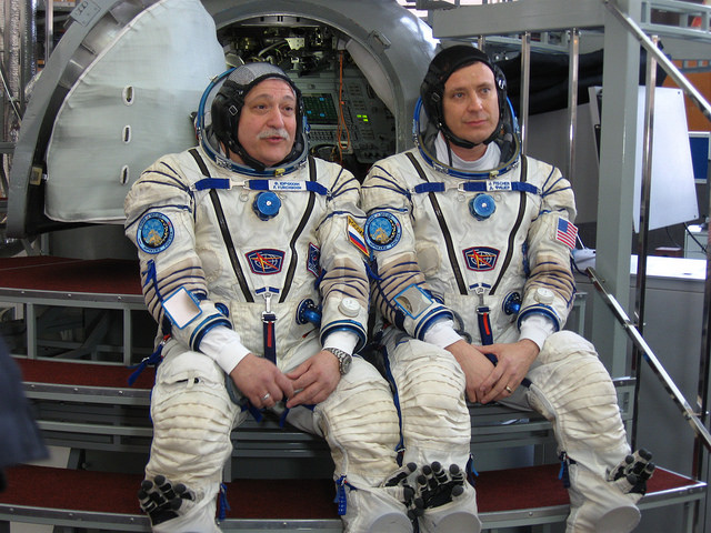 At the Gagarin Cosmonaut Training Center in Star City, Russia, Expedition 51 crewmembers Fyodor Yurchikhin of the Russian Federal Space Agency (Roscosmos, left) and Jack Fischer of NASA (right) field questions from reporters in front of a Soyuz spacecraft mockup March 31 during the second of two days of final qualification exams. Yurchikhin and Fischer will launch April 20 on the Soyuz MS-04 spacecraft from the Baikonur Cosmodrome in Kazakhstan for a four and a half month mission on the International Space Station. Expedition 51. (Rob Navias/NASA)