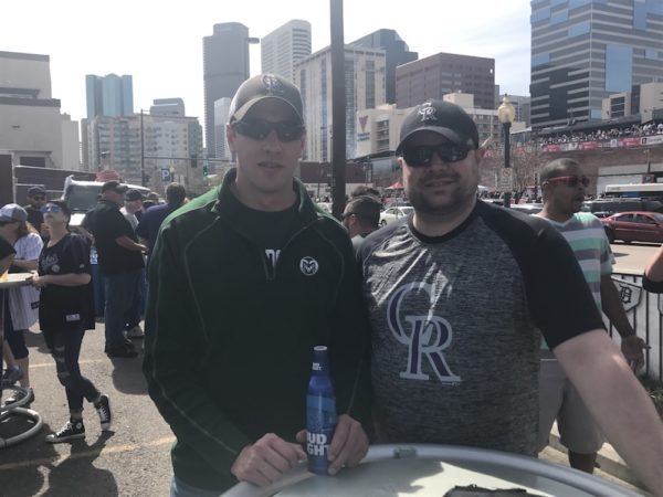 Chad Huggenberger, left, and Kris Brown at opening day. (Christian Clark/Denverite)
