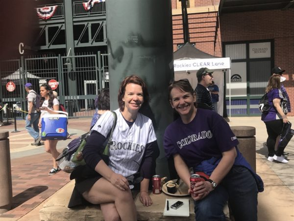 Christine Rasmussen, left, and her sister Anne Brunton at opening day. (Christian Clark/Denverite)