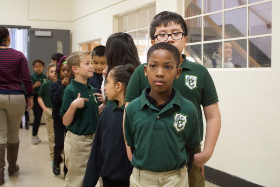 Students line up in the hallway at the Cole Arts and Science Academy in Denver. (Nic Garcia/Chalkbeat)