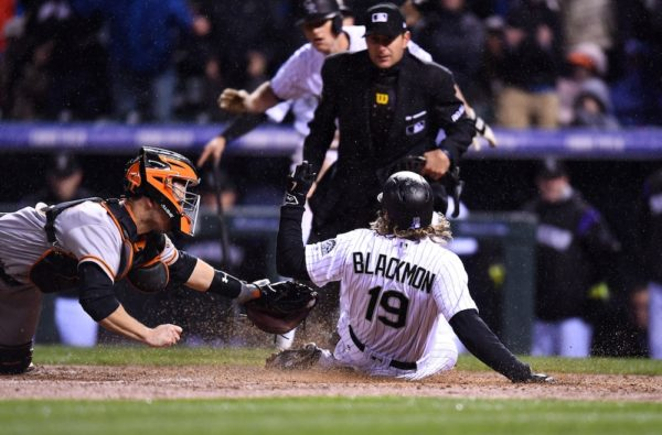 Charlie Blackmon slides in for the inside-the-park home run. (Ron Chenoy/USA Today Sports)