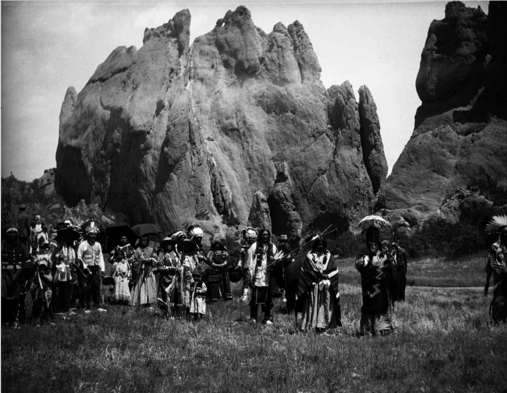 "Ute men, women, and children pose at Garden of the Gods in 1911. The photo is labeled ""moon dance."" (H.S. Poley/Western History and Genealogy Dept./Denver Public Library)"