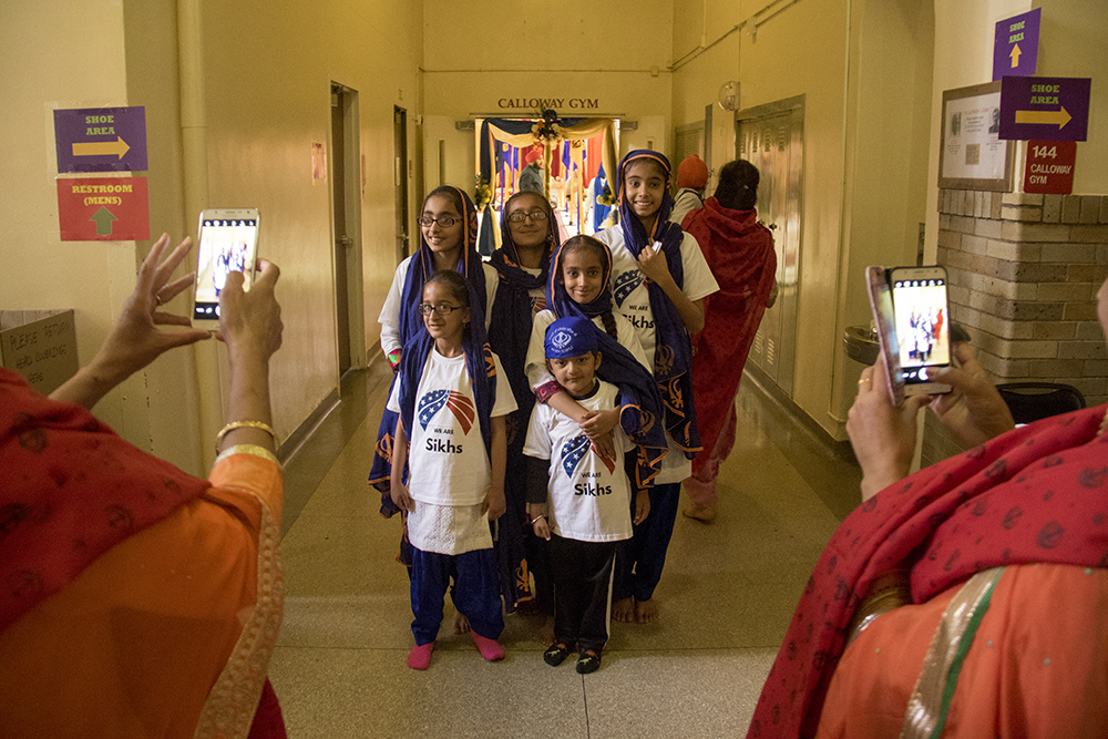 Kids pose for their moms. The second-annual Sikh festival at East High School, May 28, 2017. (Kevin J. Beaty/Denverite)  sikh; colorado singh sabha; east high school; denver; colorado; parade; kevinjbeaty; denverite;
