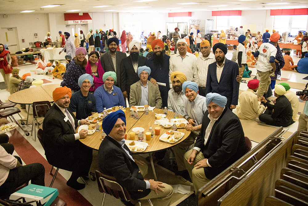 A table full of politicians in turbans. The second-annual Sikh festival at East High School, May 28, 2017. (Kevin J. Beaty/Denverite)  sikh; colorado singh sabha; east high school; denver; colorado; parade; kevinjbeaty; denverite;