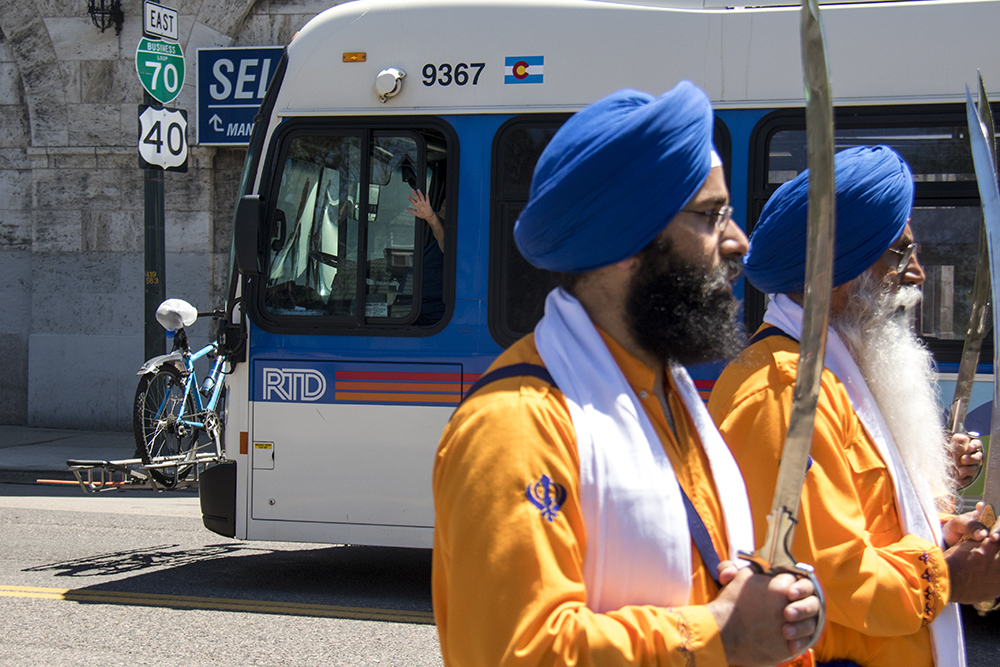 """Men ceremoniously dressed as the Panj Pyare, the """"Five Beloved Ones,"""" or the first Sikhs walk over Colfax Avenue. The second-annual Sikh parade, May 28, 2017. (Kevin J. Beaty/Denverite)  sikh; colorado singh sabha; east high school; denver; colorado; parade; kevinjbeaty; denverite;"""