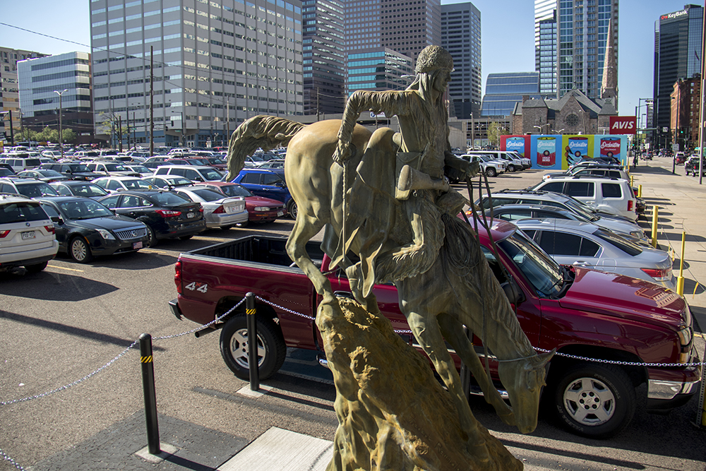 A Frederic Remington sculpture in a parking lot on Broadway. (Kevin J. Beaty/Denverite)  denver; colorado; kevinjbeaty; denverite; north capitol hill; public art; sculpture; denver art museum;