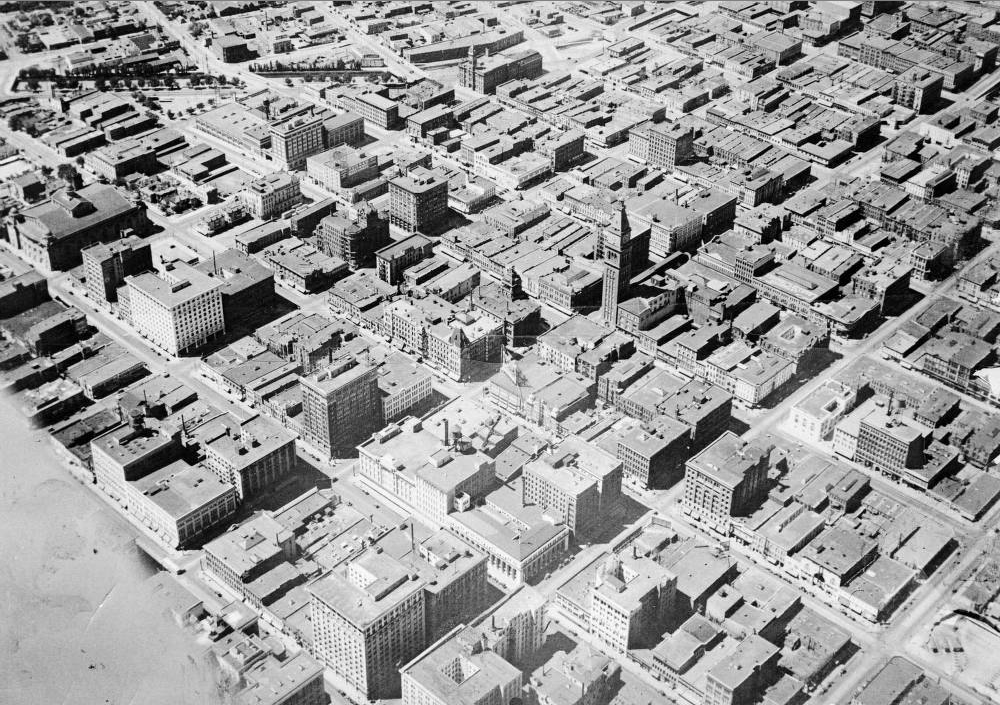 An aerial view of downtown Denver, with the Daniels and Fisher tower and 16th Street at center, between 1922 and 1930. (Harry M. Rhoads/Western History & Genealogy Dept./Denver Public Library)