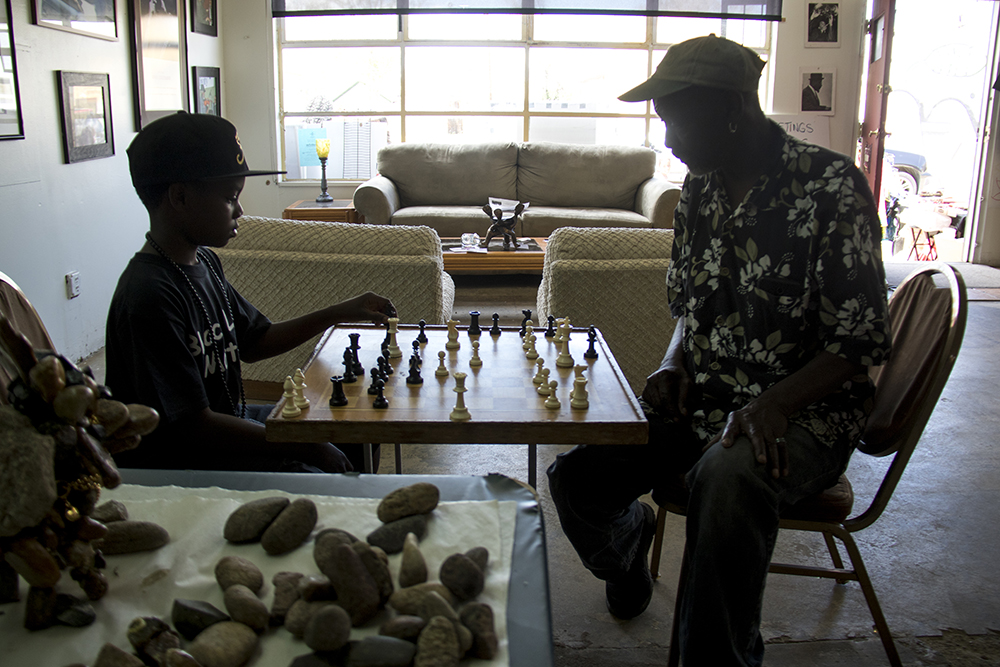 "RaShawn plays chess with Ralph ""The Human Being"" Mills inside Brother Jeff's Cultural Center in Five Points, May 13, 2017. (Kevin J. Beaty/Denverite)  brother jeff's cultural center; five points; mother's day; kevinjbeaty; denver; denverite; colorado;"