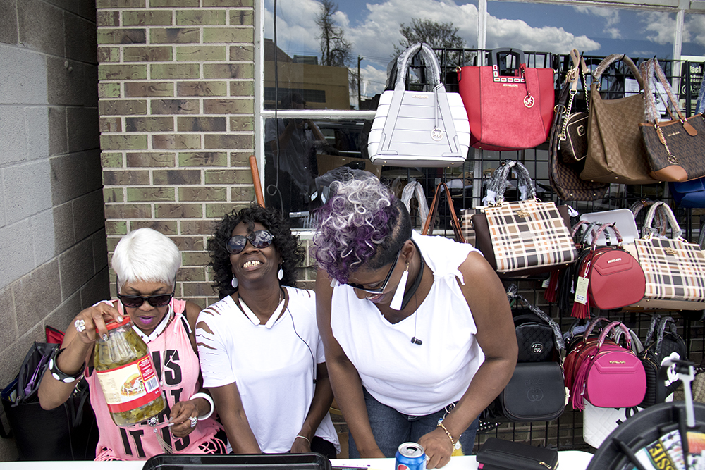 Josephine Lemon-lett (left to right), Josie Littleton and Yulanda Cross sit behind their vendor table at Black Dollar Saturdays, Brother Jeff's Cultural Center in Five Points, May 13, 2017. (Kevin J. Beaty/Denverite)  brother jeff's cultural center; five points; mother's day; kevinjbeaty; denver; denverite; colorado;
