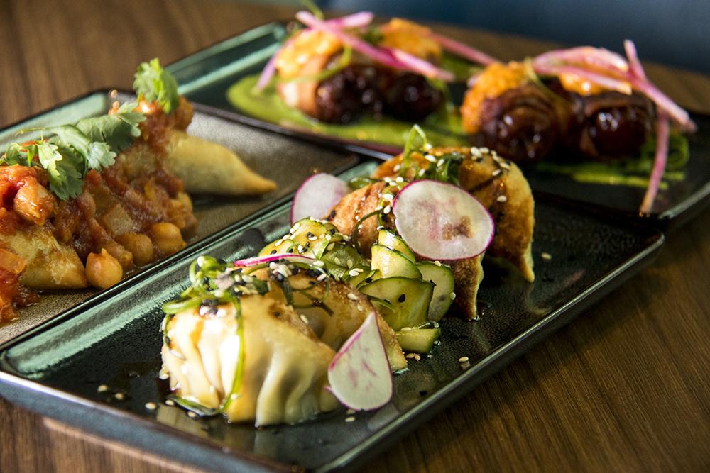 Pork gyoza, samosas and devils on horseback, appetisers at the Corner Office on Curtis Street at 14th Street. (Kevin J. Beaty/Denverite)  food; restaurant; downtown; corner office; denver; central business district;
