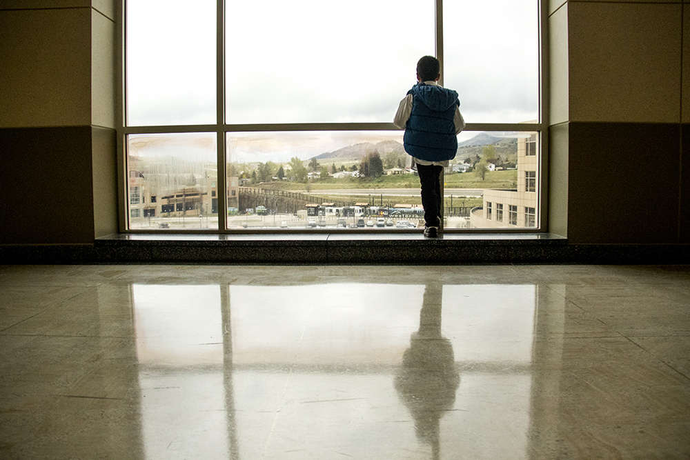 Ingrid Encalada Latorre's son Bryant gazes out of the Jefferson County courthouse window while his mom is on the stand, May 3, 2017. (Kevin J. Beaty/Denverite)  immigration; undocumented; deportation; law; court; jefferson county; golden; colorado; kevinjbeaty