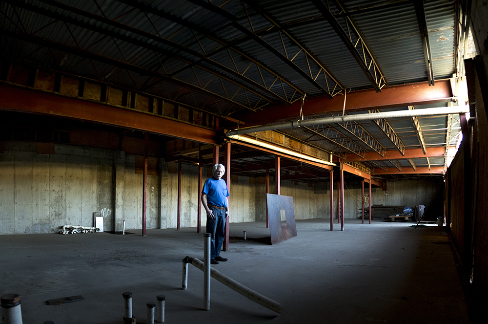 Tom Parson stands in a new space beneath the Englewood Depot that will house workshops and printing materials, May 4, 2017. (Kevin J. Beaty/Denverite)  letterpress; art; engelwood; depot; tom parson; collector; kevinjbeaty; denverite; odd spot; denver; colorado;