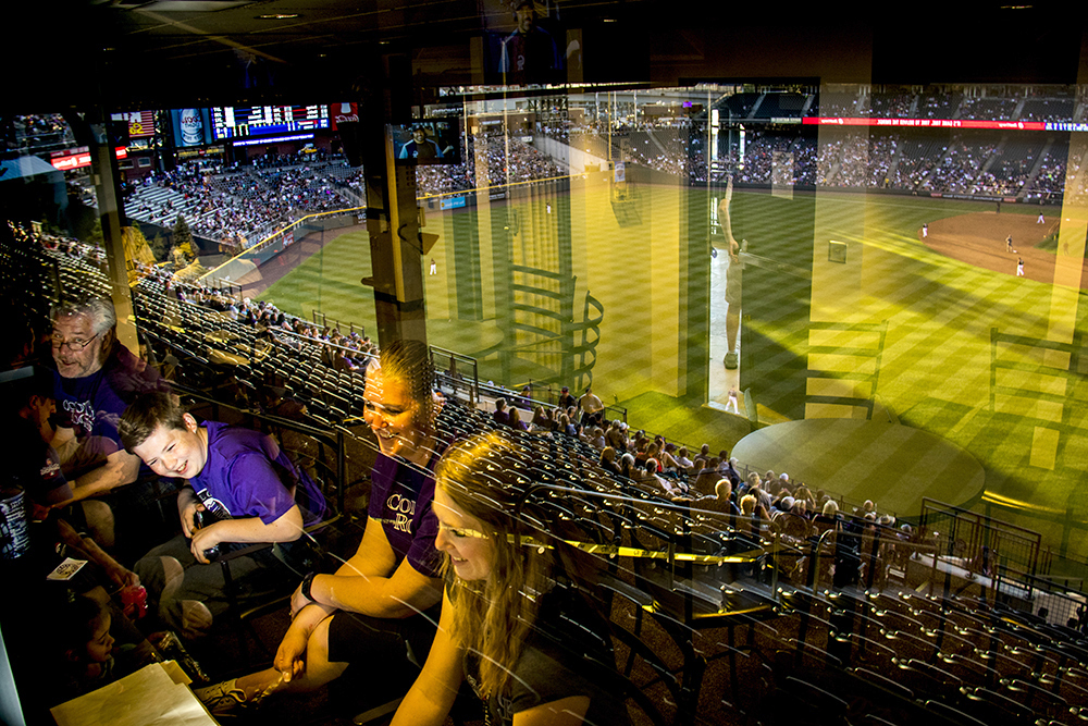 Erik West watches the Rockies from inside the Peanut Allergy Friendly Night box suite at Coors Field, May 5, 2017. (Kevin J. Beaty/Denverite)  colorado rockies; baseball; sports; coors field; peanut allergy; kevinjbeaty; denver; colorado; denverite;