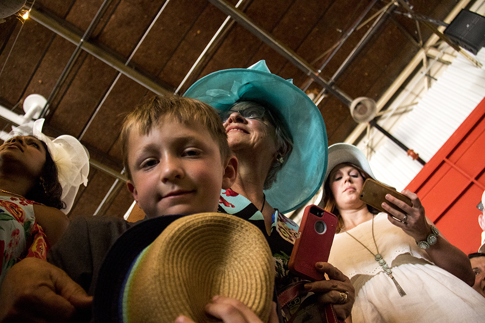 Finnegan Keyes and his grandmother Betsy await the Corgi race. A Kentucky Derby party at Stanley Marketplace, May 6, 2017. (Kevin J. Beaty/Denverite)  stanley marketplace; kentucky derby; aurora; kevinjbeaty; denverite; colorado;