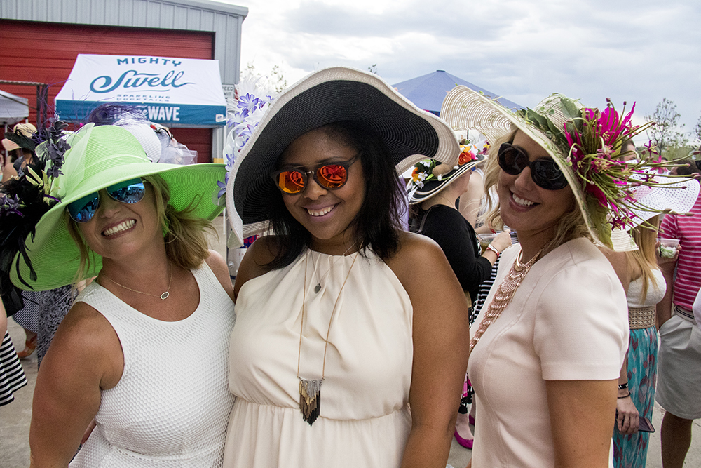Amber Hendricks, Brandi Keith and Miranda Wooten pose for a derby-hatted portrait. A Kentucky Derby party at Stanley Marketplace, May 6, 2017. (Kevin J. Beaty/Denverite)  stanley marketplace; kentucky derby; aurora; kevinjbeaty; denverite; colorado;