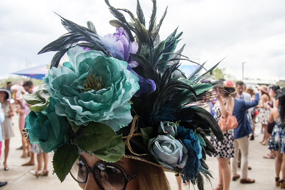 Elle Adelle and her floral hat adorned with a little bird. A Kentucky Derby party at Stanley Marketplace, May 6, 2017. (Kevin J. Beaty/Denverite)  stanley marketplace; kentucky derby; aurora; kevinjbeaty; denverite; colorado;