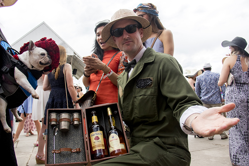 Pith-hatted Paul Laurie has a chest containing a field bar. A Kentucky Derby party at Stanley Marketplace, May 6, 2017. (Kevin J. Beaty/Denverite)  stanley marketplace; kentucky derby; aurora; kevinjbeaty; denverite; colorado;