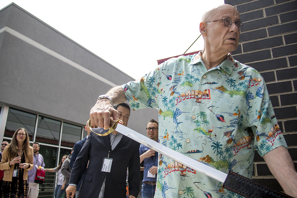 Writer James Ellroy unsheathes a sabre to open a bottle of champagne to christen the new Alamo Drafthouse on West Colfax, May 8, 2017. (Kevin J. Beaty/Denverite)  Alamo Drafthouse; food; nightlife; movie theater; cinema; sloans lake; west colfax; kevinjbeaty; denver; colorado; denverite;