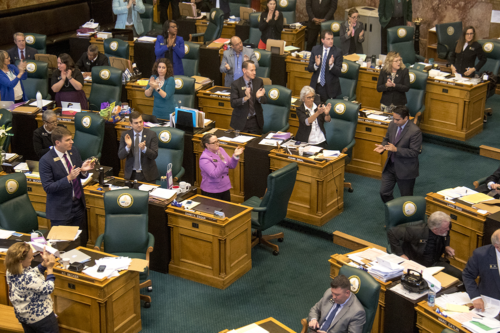 State representatives applaud after Senate Bill 17-267, Sustainability Of Rural Colorado, was passed on the last day of the legislative session, May 10, 2017. (Kevin J. Beaty/Denverite)  copolitics; house of representatives; politics; capitol; kevinjbeaty; denver; denverite; colorado;