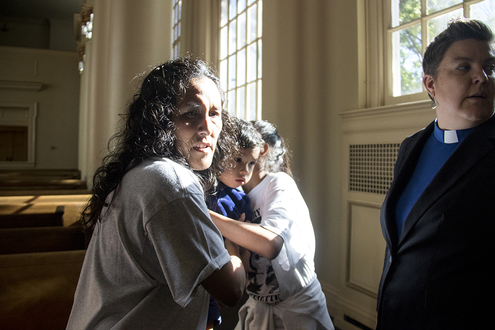 Jeanette Vizguerra holds her grandson Santiago the day she left sanctuary, May 12, 2017. (Kevin J. Beaty/Denverite)  immigration; denverite; jeanette vizguerra; deportation; kevinjbeaty; undocumented; denver; colorado;