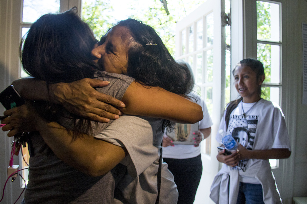 The day she announced her stay of deportation, Jeanette Vizguerra visits Ingrid Encalada, who is still in sanctuary, May 12, 2017. (Kevin J. Beaty/Denverite)  immigration; denverite; jeanette vizguerra; deportation; kevinjbeaty; undocumented; denver; colorado;