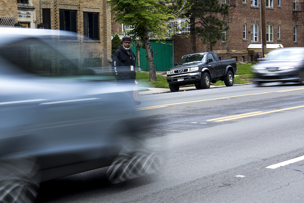 Leroy Williams  waits to cross 17th Avenue at Garfield Street to get to City Park, May 16, 2017. (Kevin J. Beaty/Denverite)  pedestrians; walkability; kevinjbeaty; denver; colorado; denverite;