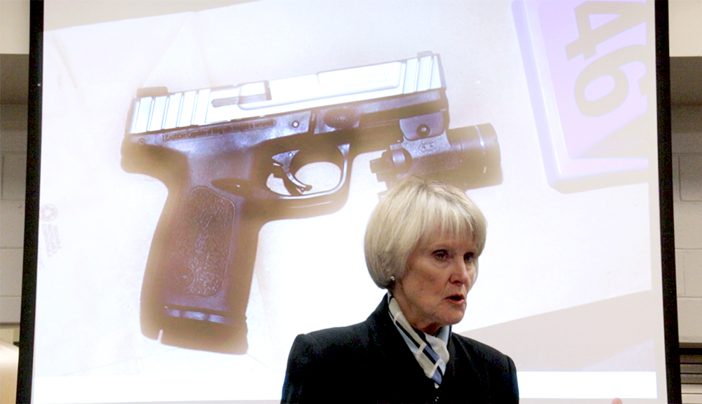 Denver District Attorney Beth McCann and a photo from a gun involved in a fatal police shootout in Montbello. (Kevin J. Beaty/Denverite)  beth mccann; denver; montbello; colorado; kevinjbeaty; denverite; police;