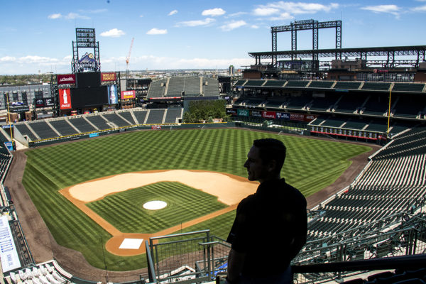 The Colorado Rockies' assistant director of digital media and publications, Julian Valentin, poses for a portrait above Coors Field, May 17, 2017. (Kevin J. Beaty/Denverite)  colorado rockies; coors field; kevinjbeaty; denver; denverite; colorado;