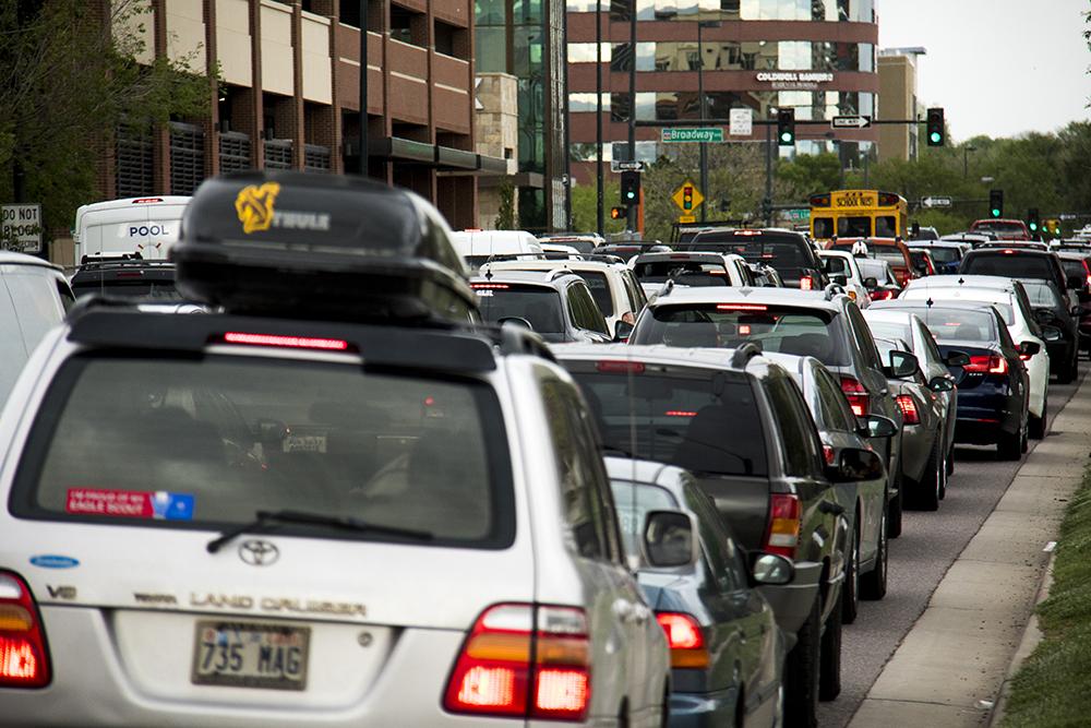 Rush hour traffic on 6th Avenue near Bannock Street, May 17, 2017. (Kevin J. Beaty/Denverite)  intersections; pedestrian; baker; development; construction; kevinjbeaty; denver; denverite; colorado;