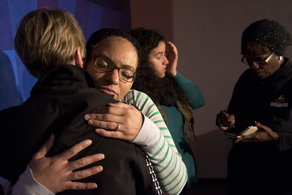 Jasmine Lima-Marin hugs Marilyn Stranske after a press conference on her husband's case at the Hans Meyer Law Office, May 19, 2017. (Kevin J. Beaty/Denverite)  rene lima-marin; immigration; deportation; hans meyer law office; kevinjbeaty; denver; colorado; denverite;