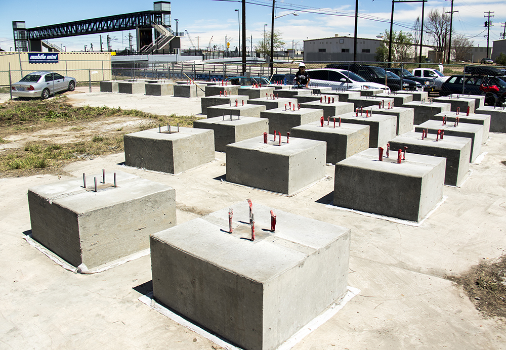 Modular foudations that will allow the village to relocate without pouring a large slab. Construction on the Beloved Community Village begins at Walnut and 38th streets, May 20, 2017. (Kevin J. Beaty/Denverite)  homeless; right to rest; tiny home village; rino; five points; denver; denverite; colorado; kevinjbeaty;
