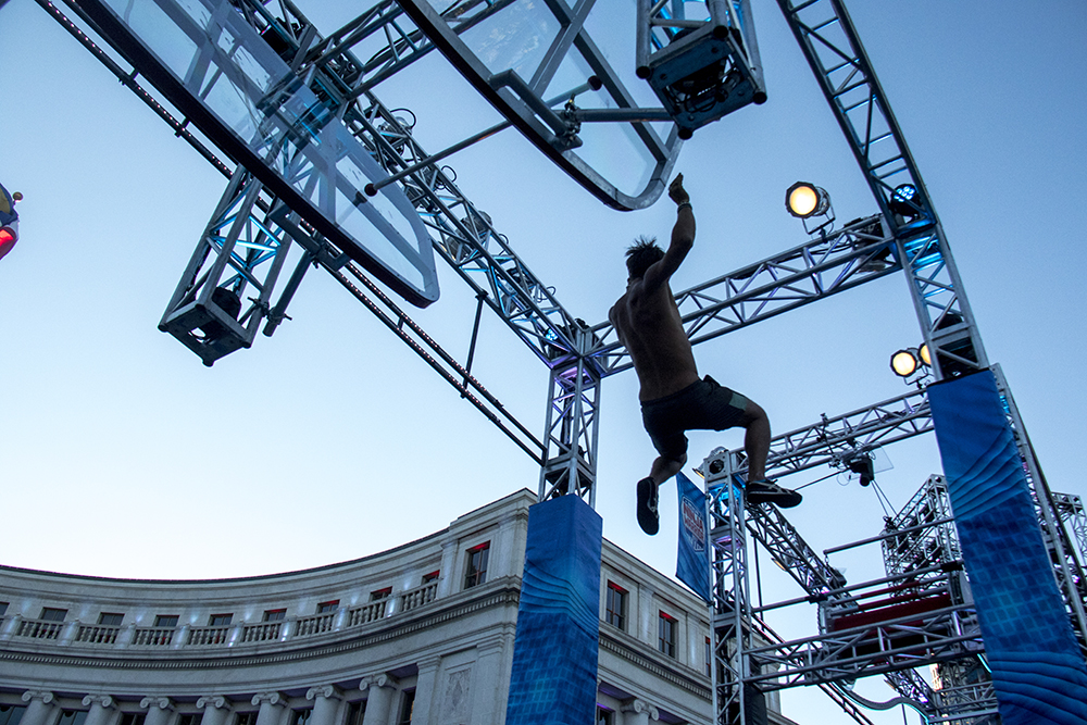 Obstacle tester Eric Bivoino demonstrates a challenge before the American Ninja Warrior finals shoot in front of the City and County Building, May 25, 2017. (Kevin J. Beaty/Denverite)american ninja warrior; civic center park; denver; denverite; colorado; kevinjbeaty