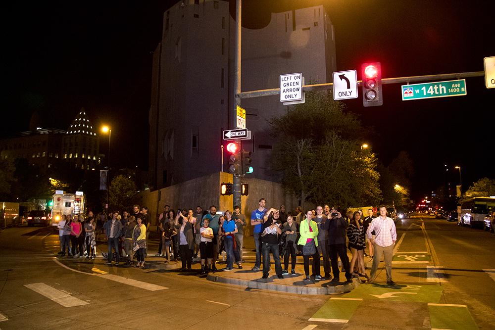 Spectators watch the American Ninja Warrior finals shoot from 14th Avenue and Bannock Street, May 25, 2017. (Kevin J. Beaty/Denverite)  american ninja warrior; civic center park; denver; denverite; colorado; kevinjbeaty