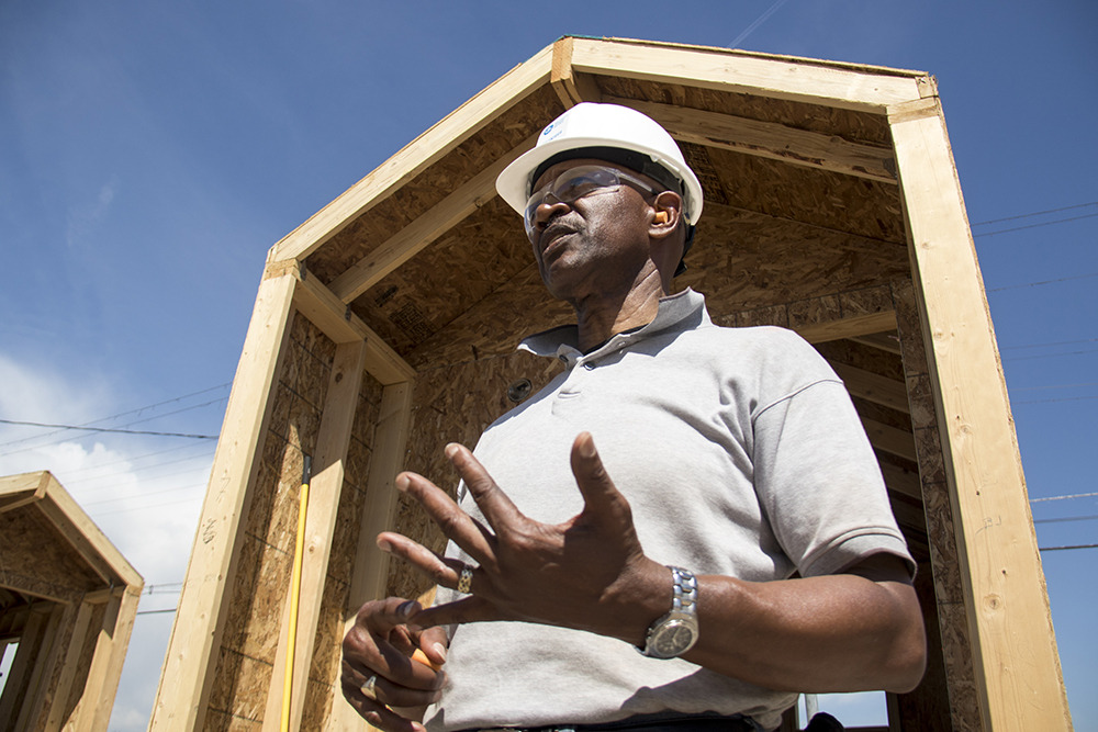 Mennonite Disaster Service volunteer James Harrell gives a tour of construction at the Beloved Community Village at Walnut and 38th streets, May 31, 2017. (Kevin J. Beaty/Denverite)  tiny home village; homeless; right to rest; urban camping ban; denver; colorado; denverite; five points; kevinjbeaty;