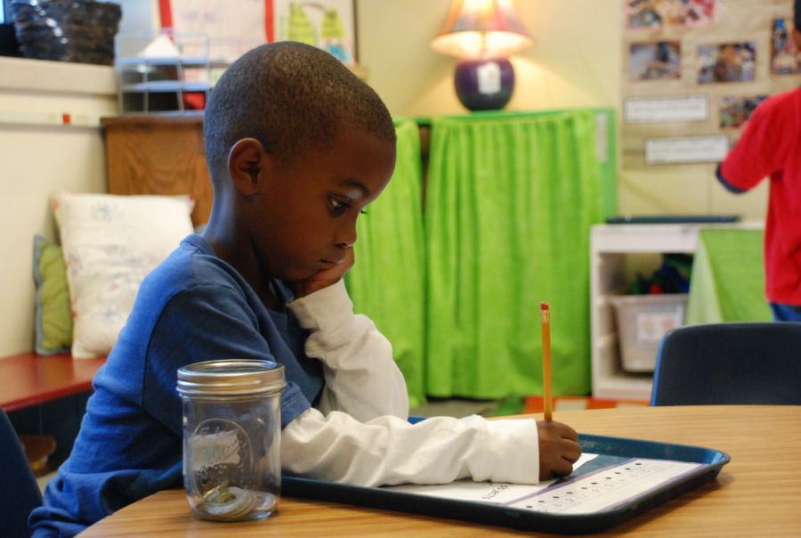 A student works at Tollgate Elementary School in Aurora. (Nic Garcia/Chalkbeat)