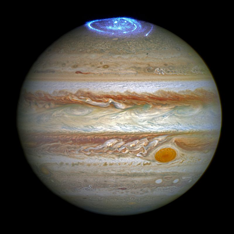 The ultraviolet light of Jupiter's aurora is made visible in a 2016 composite image from the Hubble Space Telescope. (NASA)
