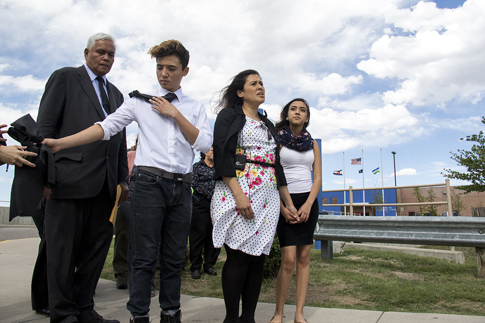 Isidro Quinana's pastor, Joel Barnedo (left to right), son Angel, wife Erica and daughter Ana Victoria stand outside of the GEO private detention facility after hearing his deportation order was cancelled, May 15, 2017. (Kevin J. Beaty/Denverite)  isidro quintana; aurora; GEO; immigration; deportation; kevinjbeaty; denverite; colorado