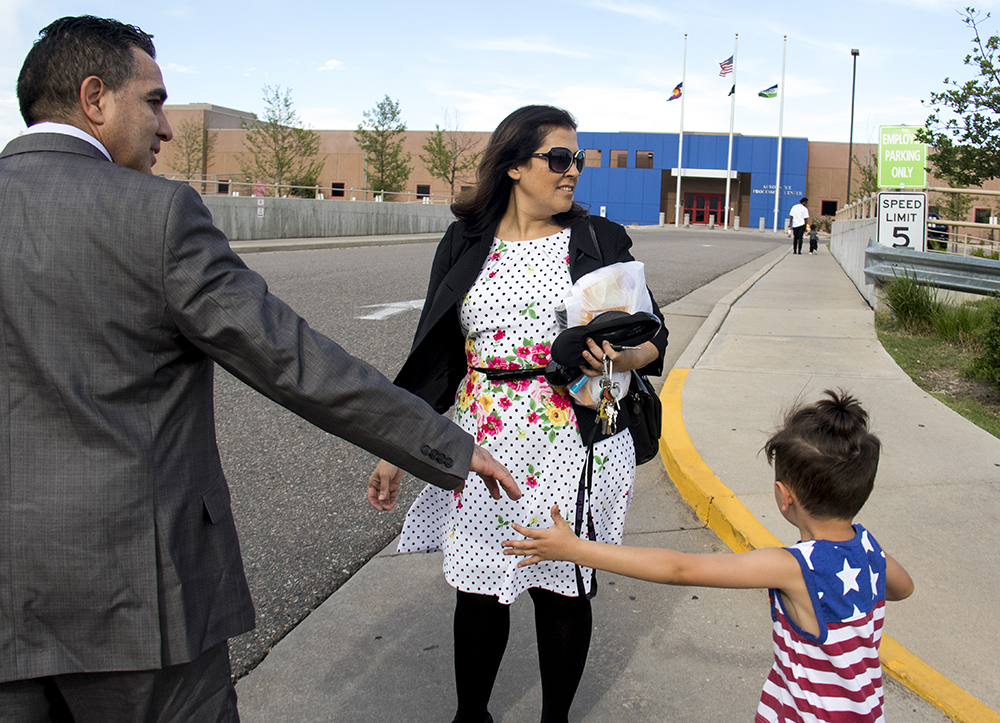 Isidro Quintana reaches for his grandson Reymi's hand as a woman and young child walk into Aurora's GEO immigration detention facility, May 15, 2017. (Kevin J. Beaty/Denverite)  isidro quintana; aurora; GEO; immigration; deportation; kevinjbeaty; denverite; colorado