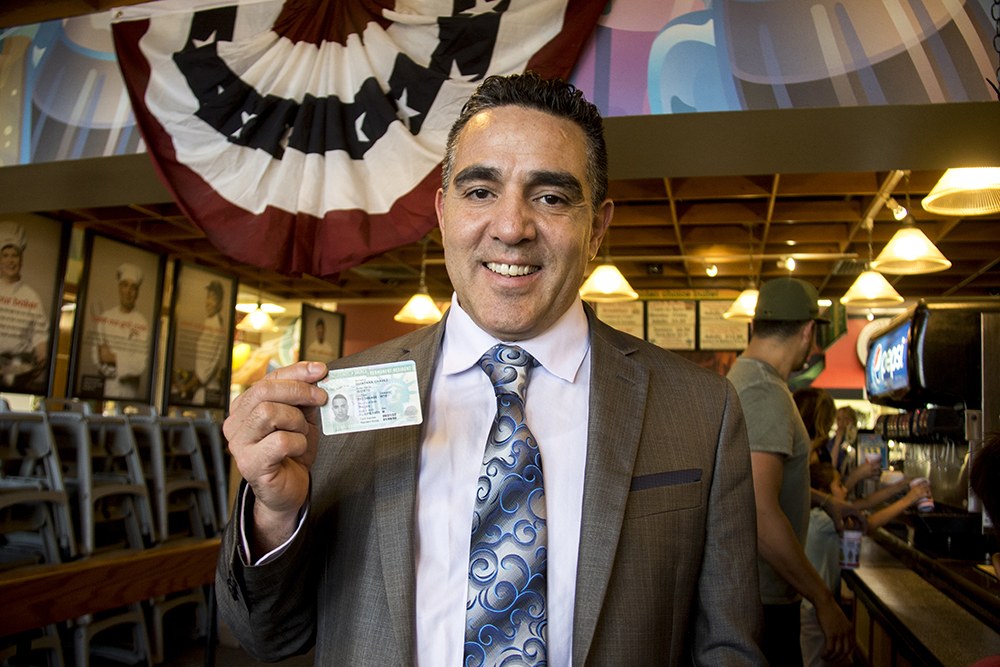 Isidro Quintana and his green card. Golden Corral in Centennial, May 15, 2017. (Kevin J. Beaty/Denverite)  kevinjbeaty; denverite; colorado; isidro quintana; GEO; immigration; deportation;