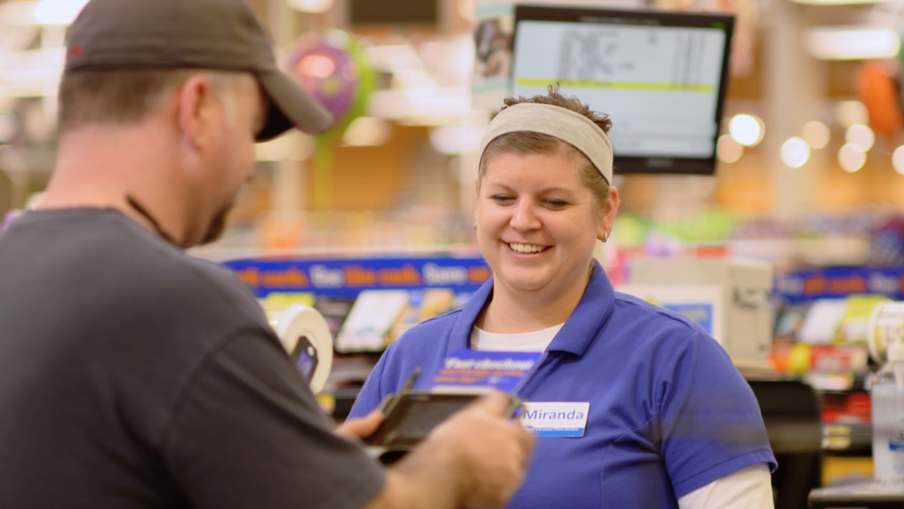 A cashier for the Kroger Co. checks out a customer. (Courtesy of Kroger Co.)