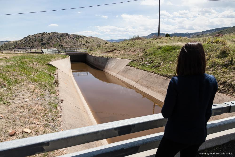 Emily Morris looks out over the South Boulder Canal. (Mark McDade/NREL)