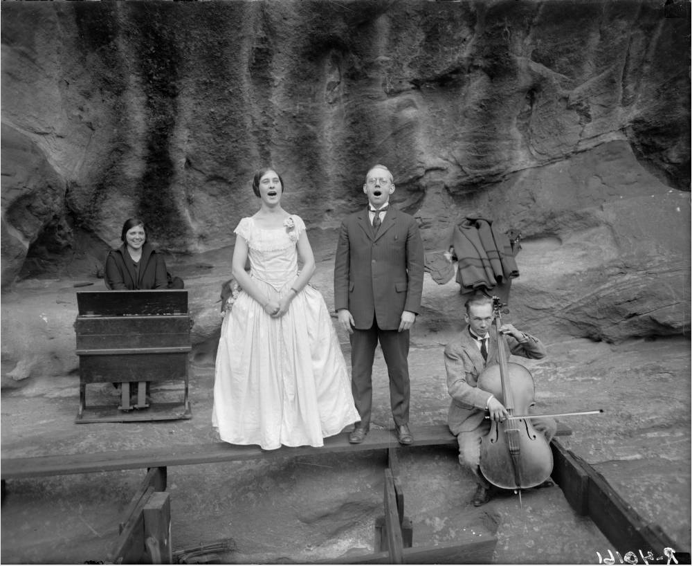 Men and women sing, play a portable piano and cello at the Garden of Angels, also known as Red Rocks Amphitheater circa 1908. (Harry Mellon Rhoads/Western History & Genealogy Dept./Denver Public Library)