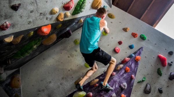 Corporal Tyler Bukoski, computer maintainer, 15th Marine Expeditionary Unit, maneuvers, parallel to the floor, along a wall at a rock climbing gym in Carlsbad, California, June 27, 2014. (U.S. Marine Corps/Cpl. Emmanuel Ramo)