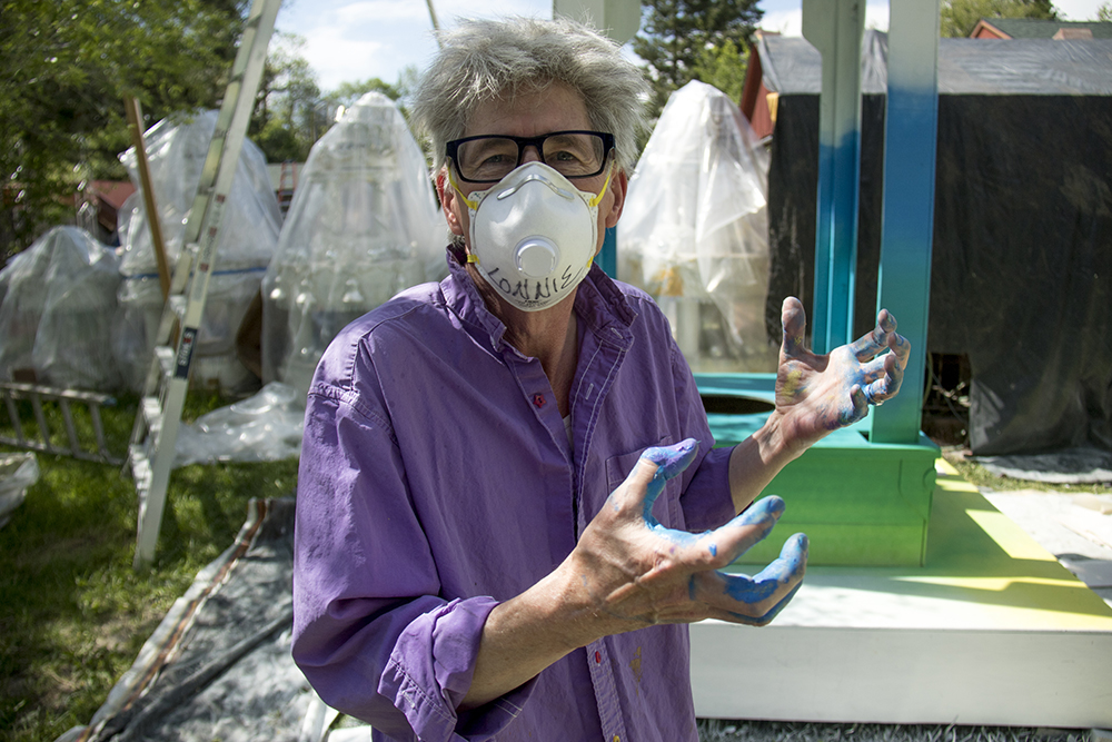 "Lonnie Hanzon at work on the ""Shrine to Humanity"" behind his home studio in Lakewood, May 31, 2017. (Kevin J. Beaty/Denverite)  lgbtq; pride; lonnie hanzon; public art; kevinjbeaty; denver; denverite; colorado; lakewood; shrine to humanity;"