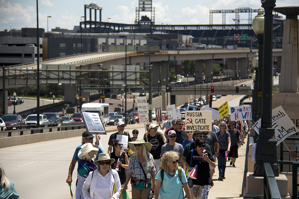 Protesters walk over the 20th Street Bridge during the March for Truth, June 3, 2017. (Kevin J. Beaty/Denverite)  protest; march for truth; kevinjbeaty; denver; colorado; denverite; commons park;