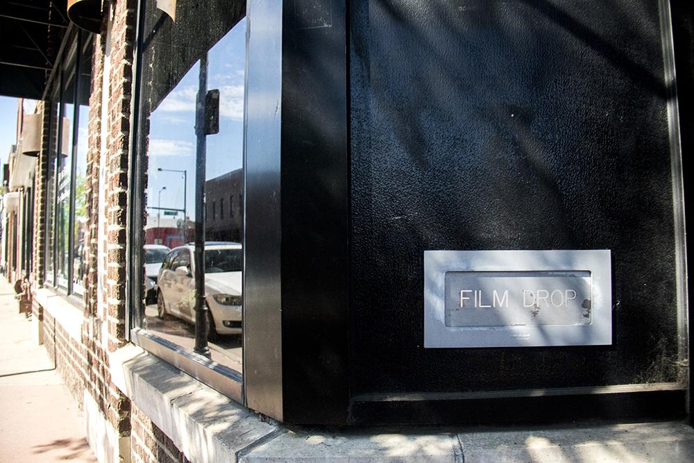 An old film drop slot into John Fielder's Colorado on Santa Fe Drive. (Kevin J. Beaty/Denverite)  art district on santa fe; gallery; fine art; kevinjbeaty; denver; colorado; denverite; lincoln park;